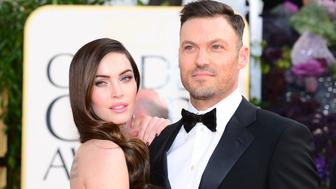 Actress Megan Fox and actor Brian Austin Green arrive at the Golden Globe awards ceremony in Beverly Hills on January 13, 2013. AFP PHOTO / Frederic J. BROWN        (Photo credit should read FREDERIC J. BROWN/AFP/Getty Images)