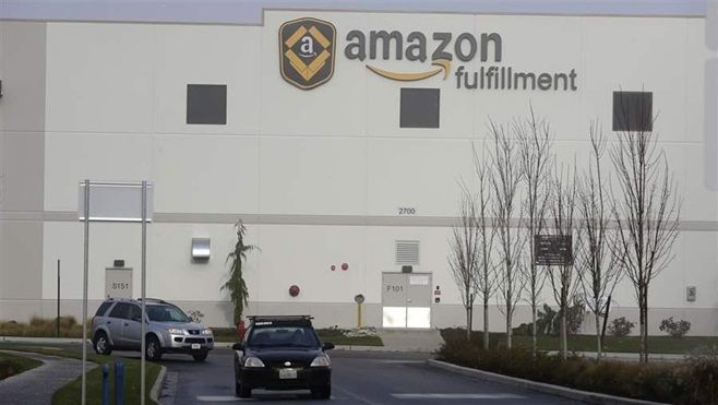 Cars drive away from an Amazon fulfillment center in DuPont, Washington. Twenty-four states are conducting an amnesty program