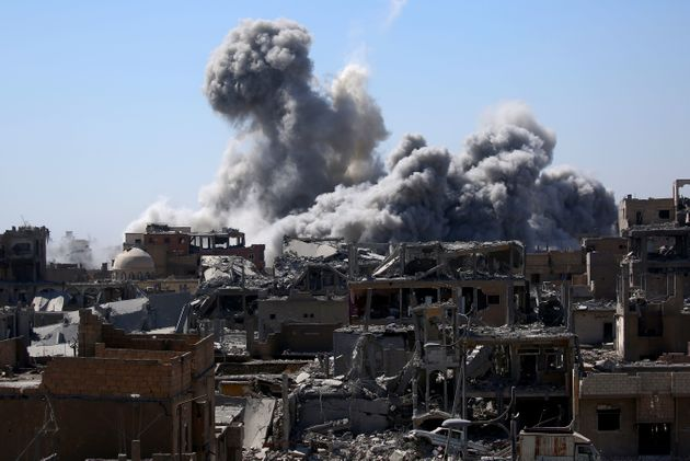 Smoke billows in Raqqa on Sept. 3.