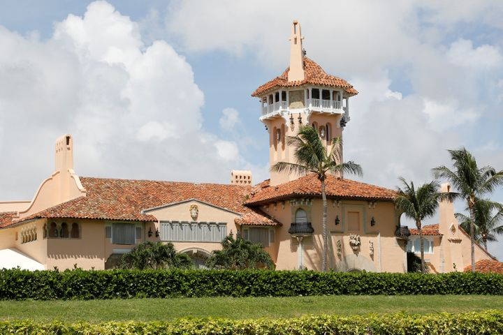 President Donald Trump's Mar-a-Lago mansion is shown with shutters on the windows Friday after a mandatory evacuation order w