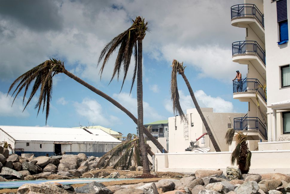 A man looks on over the devastation of Hurricane Irma in Sint Maarten.