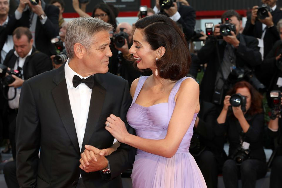 George Clooney and Amal Clooney walk the red carpet ahead of the 'Suburbicon' screening during the 74th Venice Film Festival