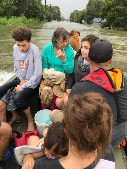 Tim Miller's granddaughter Natalie (front right), with other members of her family boating to safety in the aftermath o