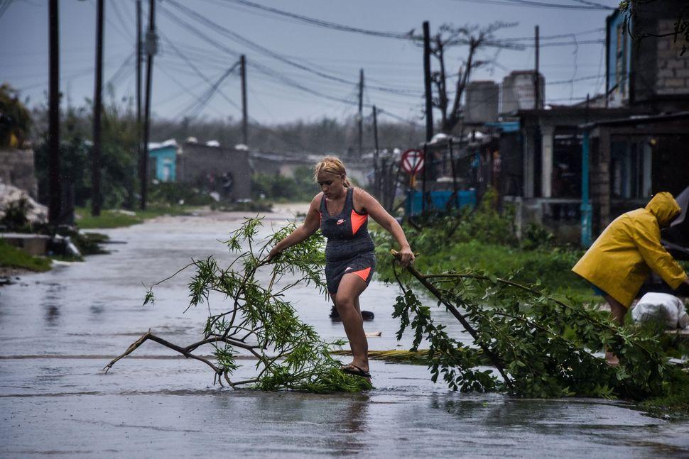 Local residents return home in Villa Clara province, east of Havana.