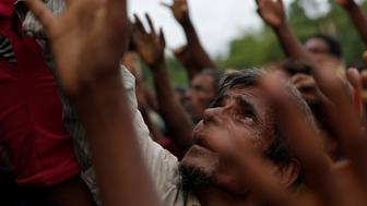 Rohingya refugees stretch their hands to receive food distributed by local organizations in Kutupalong, Bangladesh, September 9, 2017. REUTERS/Danish Siddiqui