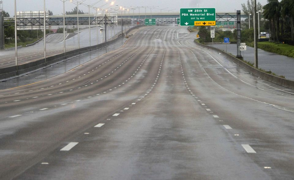 A freeway is empty as winds and rain in the outer bands of Hurricane Irma arrive in Miami.