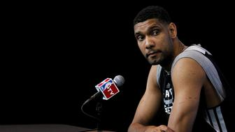 San Antonio Spurs forward Tim Duncan attends a media session for their NBA Finals basketball series against Miami Heat in San Antonio, Texas June 6, 2014.  REUTERS/Mike Stone/File Photo