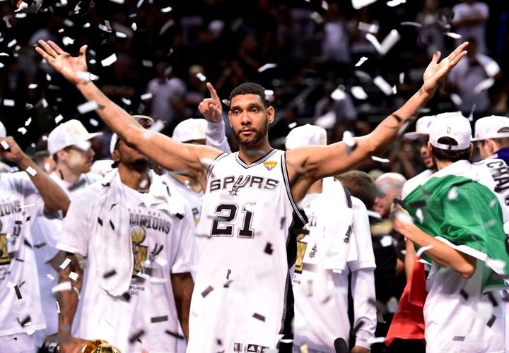 Tim Duncan celebrates the last of his five NBA championships in 2014.