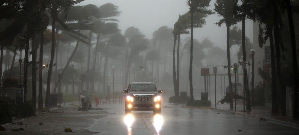 A vehicle drives along Ocean Drive in South Beach.