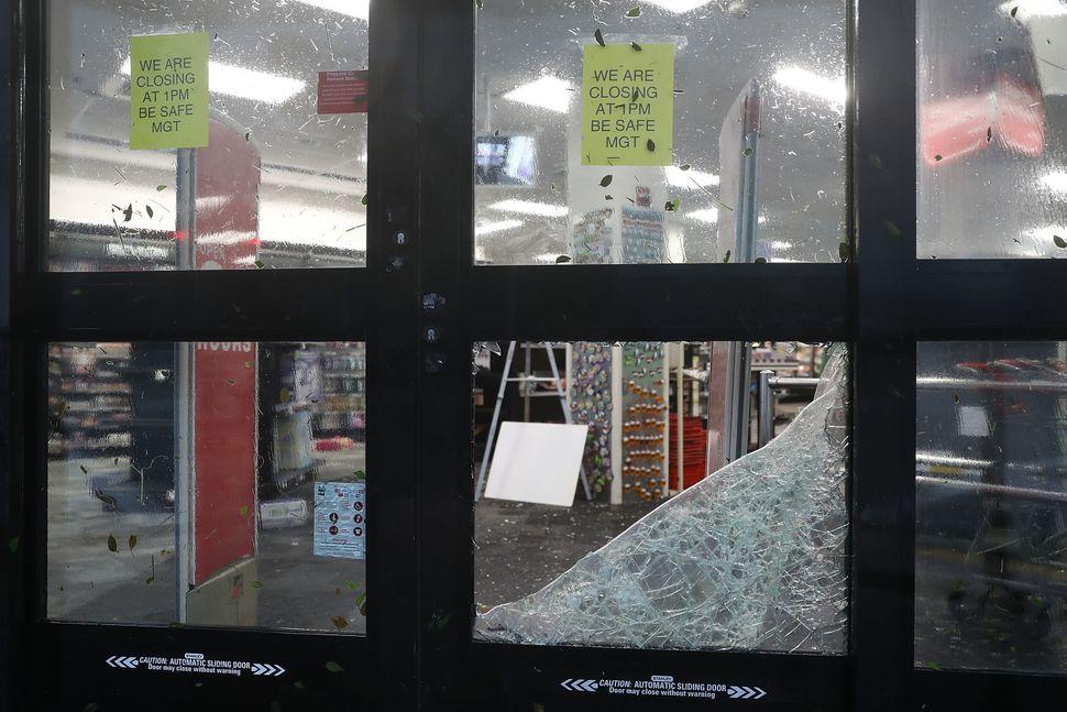 A store window is broken in Miami, Florida.