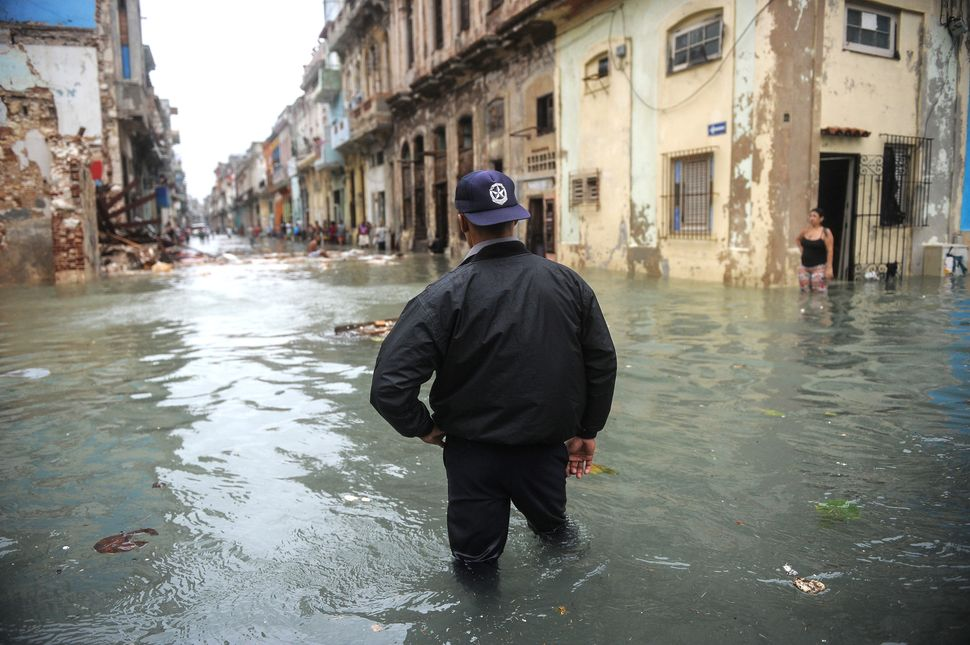 A Cuban wades through a flooded street in Havana, on September 10, 2017. Deadly Hurricane Irma battered central Cuba on Satur