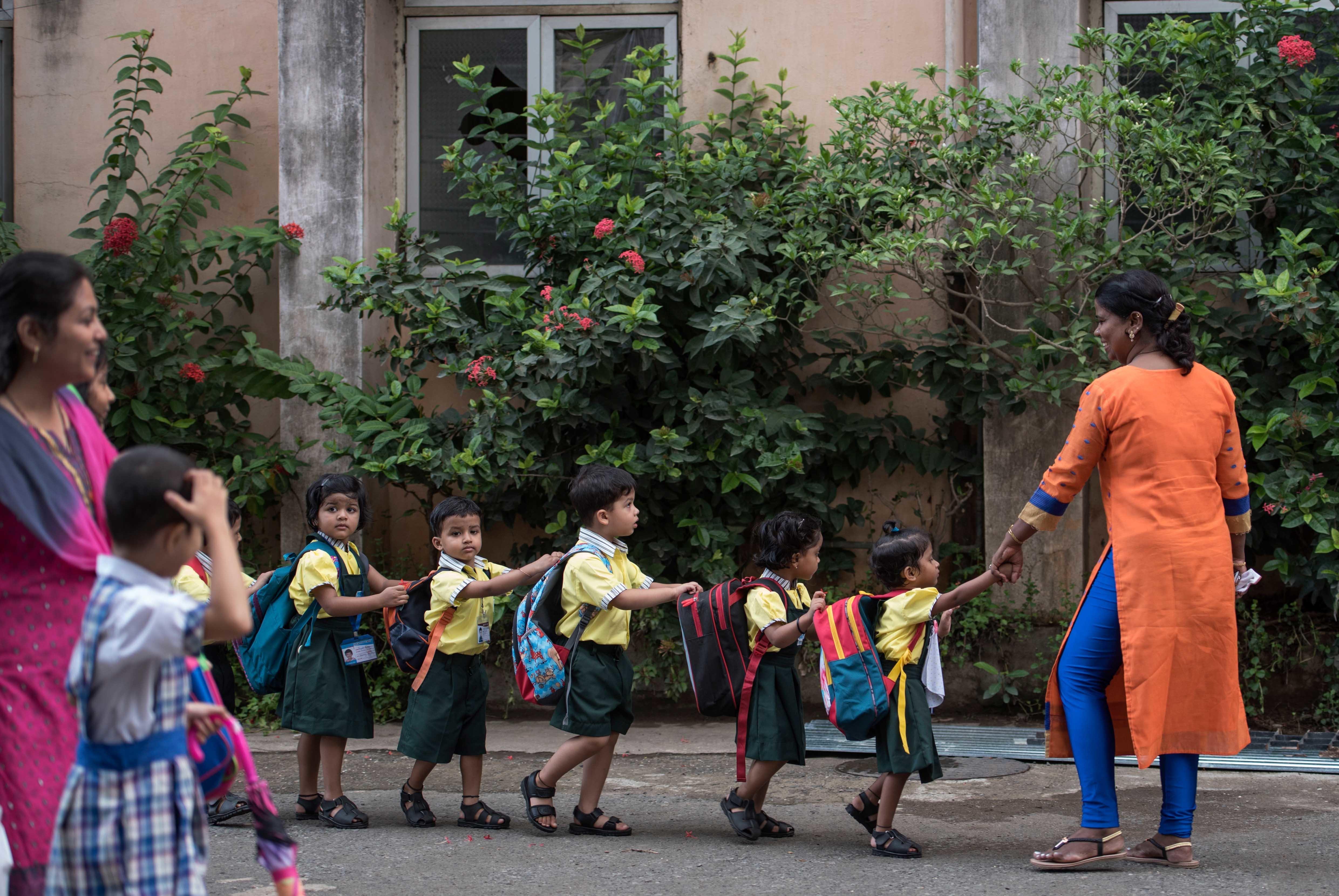Children enjoy the first day of school at Mahila Sangh School, Vile Parle in Mumbai, India.