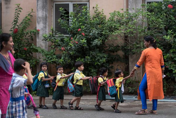 Children enjoy the first day of school at Mahila Sangh School, Vile Parle in Mumbai, India.