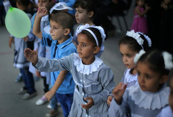 Palestinian schoolchildren play on the first day of a new school year, at a United Nations-run school in Deir al-Balah refuge