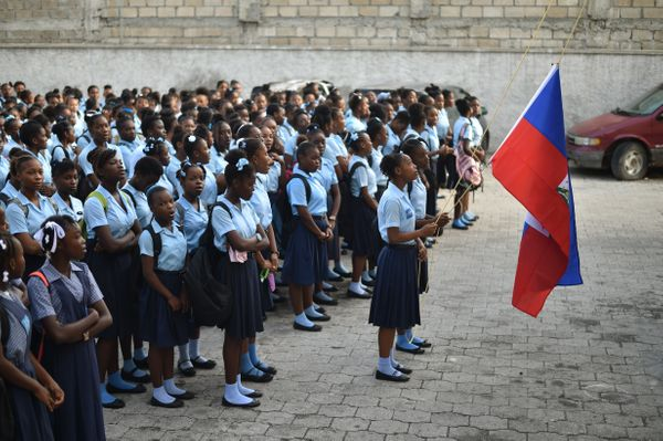 Students prepare for the first day of school at the Lycee du Cent Cinquantatenaire, in Port-au-Prince.