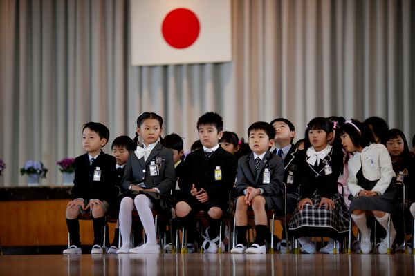Children attend a ceremony on their first day of school at Shimizu elementary school in Fukushima, Japan.