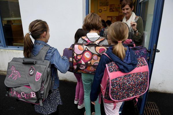Pupils enter their classroom in a primary school on the first day of the new school year on Sept. 4, 2017, in Quimper, wester