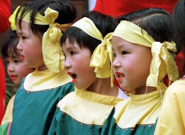 Young Vietnamese children are dressed up and ready to perform for parents and local officials on the first day of the school