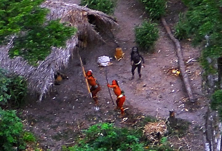 Members of an uncontacted tribe in Brazil's Amazon Basin were photographed by air in 2008. At least 10 members of a tribe in this region were reportedly killed by gold miners last month.