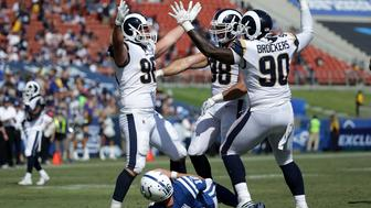 LOS ANGELES, CA - SEPTEMBER 10:  Michael Brockers #90, Matt Longacre #96 and Connor Barwin #98 of the Los Angeles Rams celebrate after a sack against Scott Tolzien #16 of the Indianapolis Colts during the third quarter at the Los Angeles Memorial Coliseum on September 10, 2017 in Los Angeles, California.  (Photo by Jeff Gross/Getty Images)