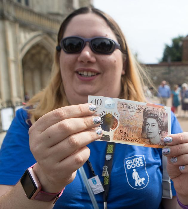 Jemma Brown, from Guide Dogs, tests the feature on the new £10
