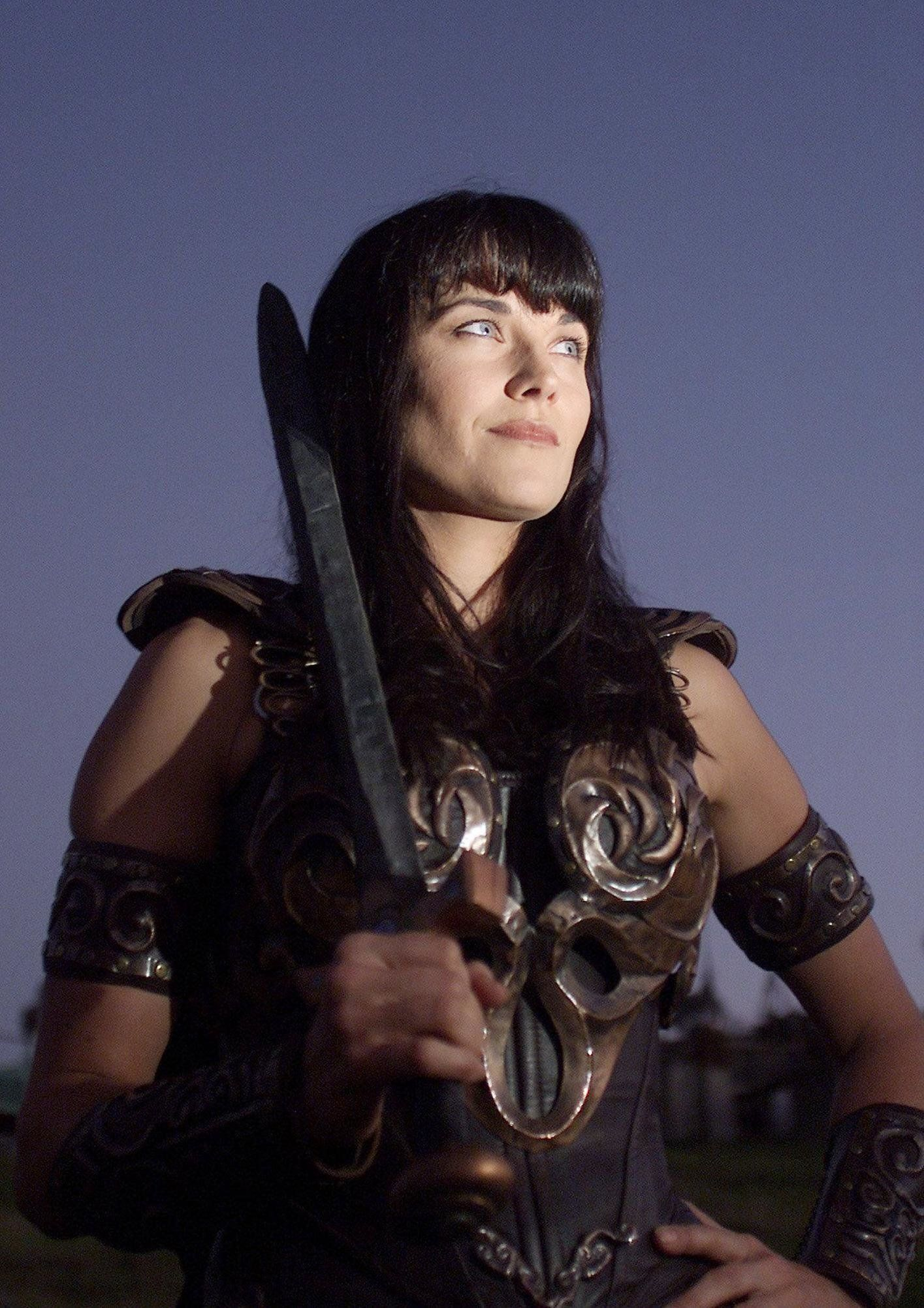 "Actress Lucy Lawless playing the character ""Xena"" while filming for the last episode of ""Xena, the Warrior Princess."""