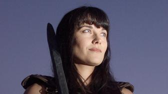 (NEW ZEALAND OUT) New Zealand actress Lucy Lawless, who plays the character 'Xena', stands on the set at dusk during the final night of filming for the last episode of 'Xena, the Warrior Princess' 30 March, 2001. The top rated series is shot in New Zealand and shown in 115 countries. Lawless, 33, was tight-lipped about Xena 's final fate. AFP PHOTO (Photo credit should read RICHARD ROBINSON/AFP/Getty Images)
