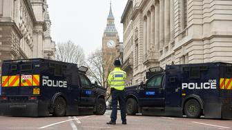 A police officer stands in front of armoured police personnel carriers on a street leading to the Houses of Parliament in central London on March 24, 2017 two days after the March 22 terror attack on the British parliament and Westminster Bridge.  At least four people were killed and 40 injured after being run over and stabbed in a lightning attack at the gates of British democracy attributed by police to 'Islamist-related terrorism'. / AFP PHOTO / NIKLAS HALLE'N        (Photo credit should read NIKLAS HALLE'N/AFP/Getty Images)