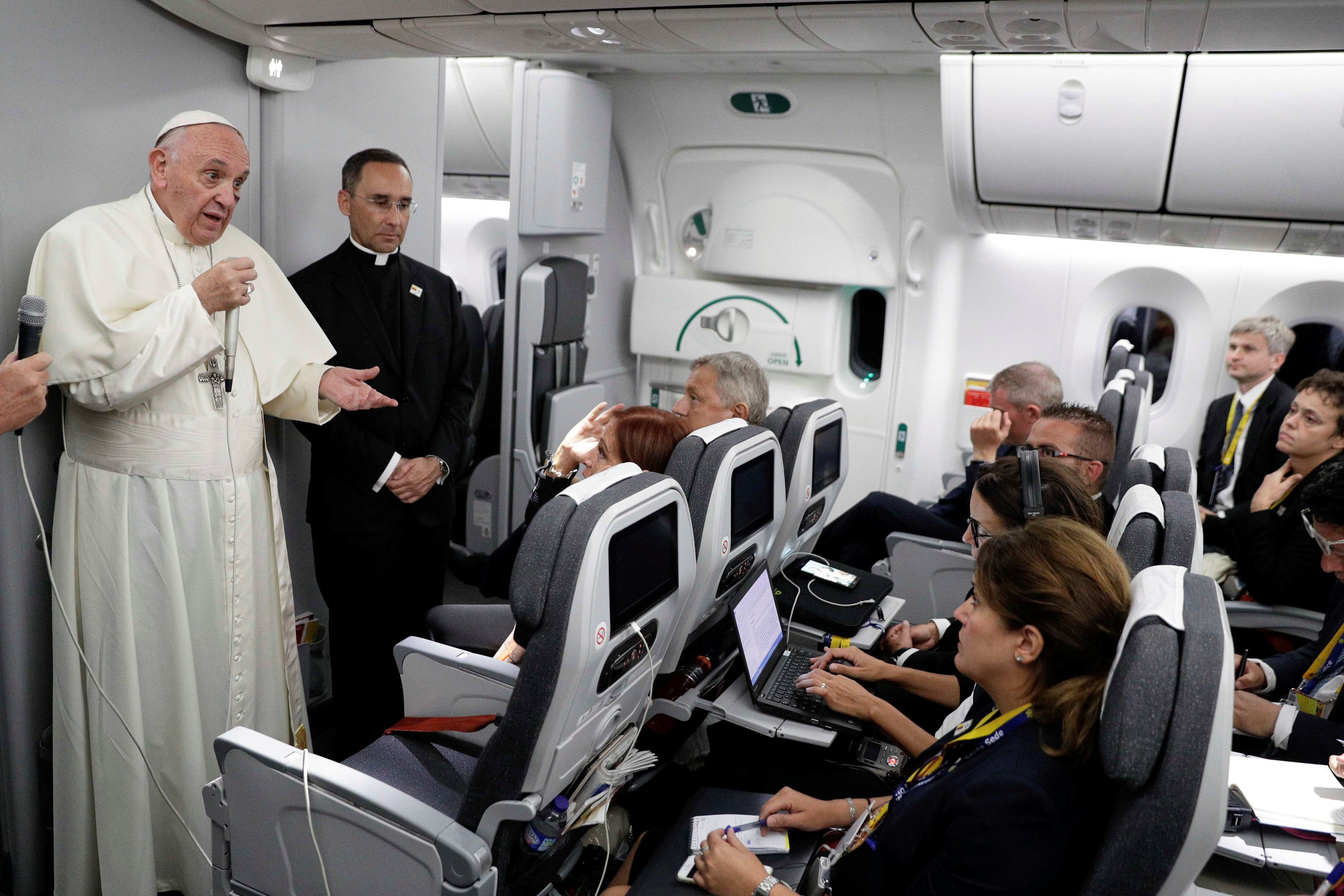 Pope Francis talks to journalists during a press conference aboard a plane to Rome at the end of his visit to Colombia Septem