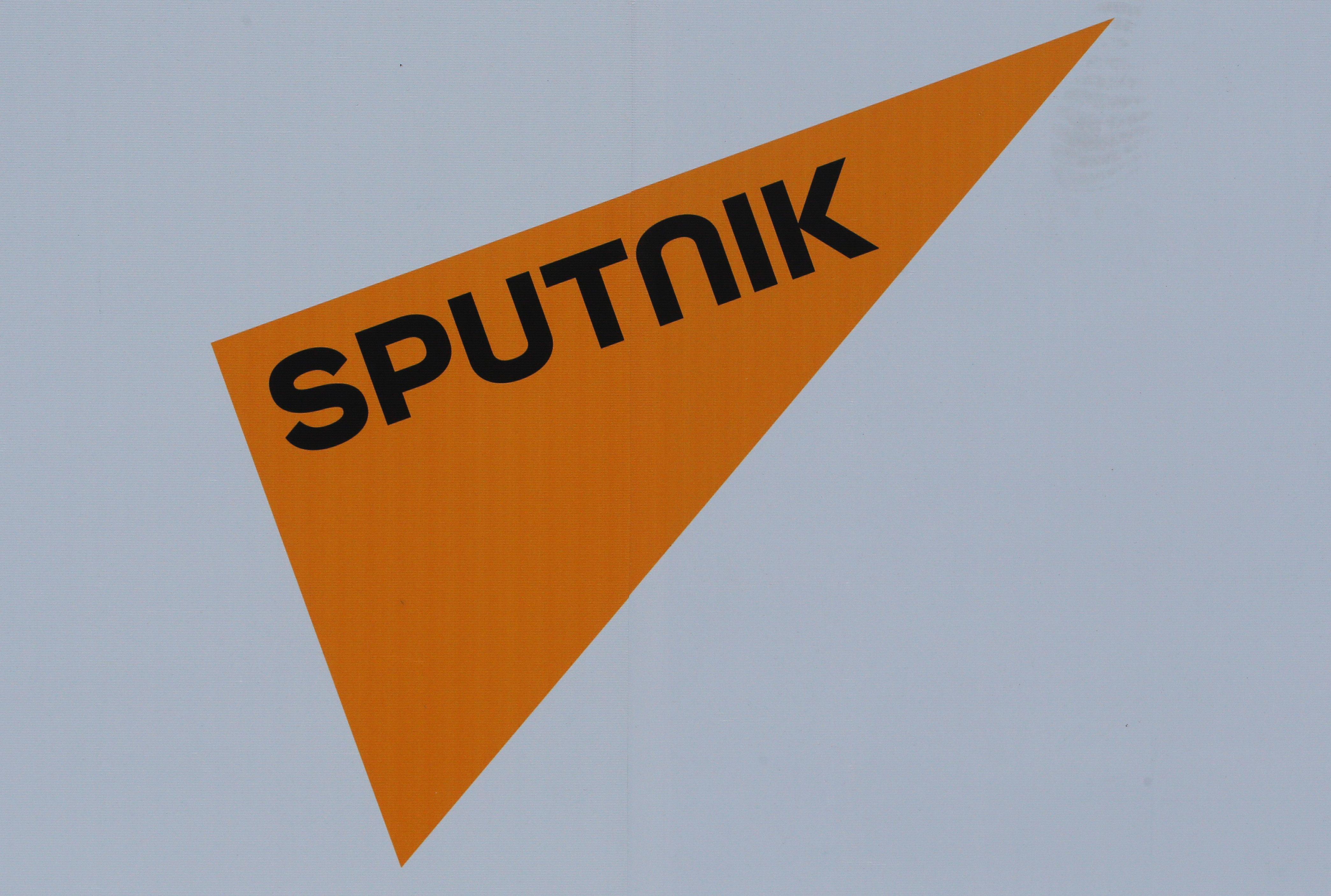 The logo of Russian state news agency Sputnik is seen on a board at the St. Petersburg International Economic Forum 2017 (SPIEF 2017) in St. Petersburg, Russia, June 1, 2017. Picture taken June 1, 2017. REUTERS/Sergei Karpukhin