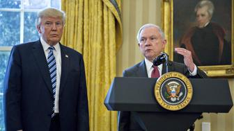 Jeff Sessions, U.S. attorney general, speaks as U.S. President Donald Trump, left, listens after Sessions was sworn in by U.S. Vice President Mike Pence, not pictured, in the Oval Office of the White House in Washington, D.C., U.S., on Thursday, Feb. 9, 2017. The Senate yesterday confirmed Sessions as attorney general after more than a day of contentious debate that took an unusual turn when Republicans silenced Democratic Senator Elizabeth Warren. Photographer: Andrew Harrer/Bloomberg via Getty Images