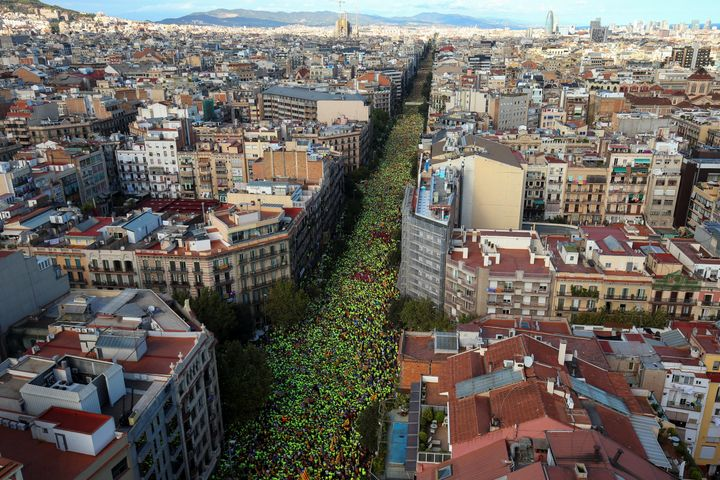 Thousands of participants wear green t-shirts provided by the National Catalan Assembly (ANC) during a rally on Catalonia's n