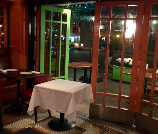 A re-staging of the table by the window at the<em> Trattoria Dell' Arte</em> some 20 years later