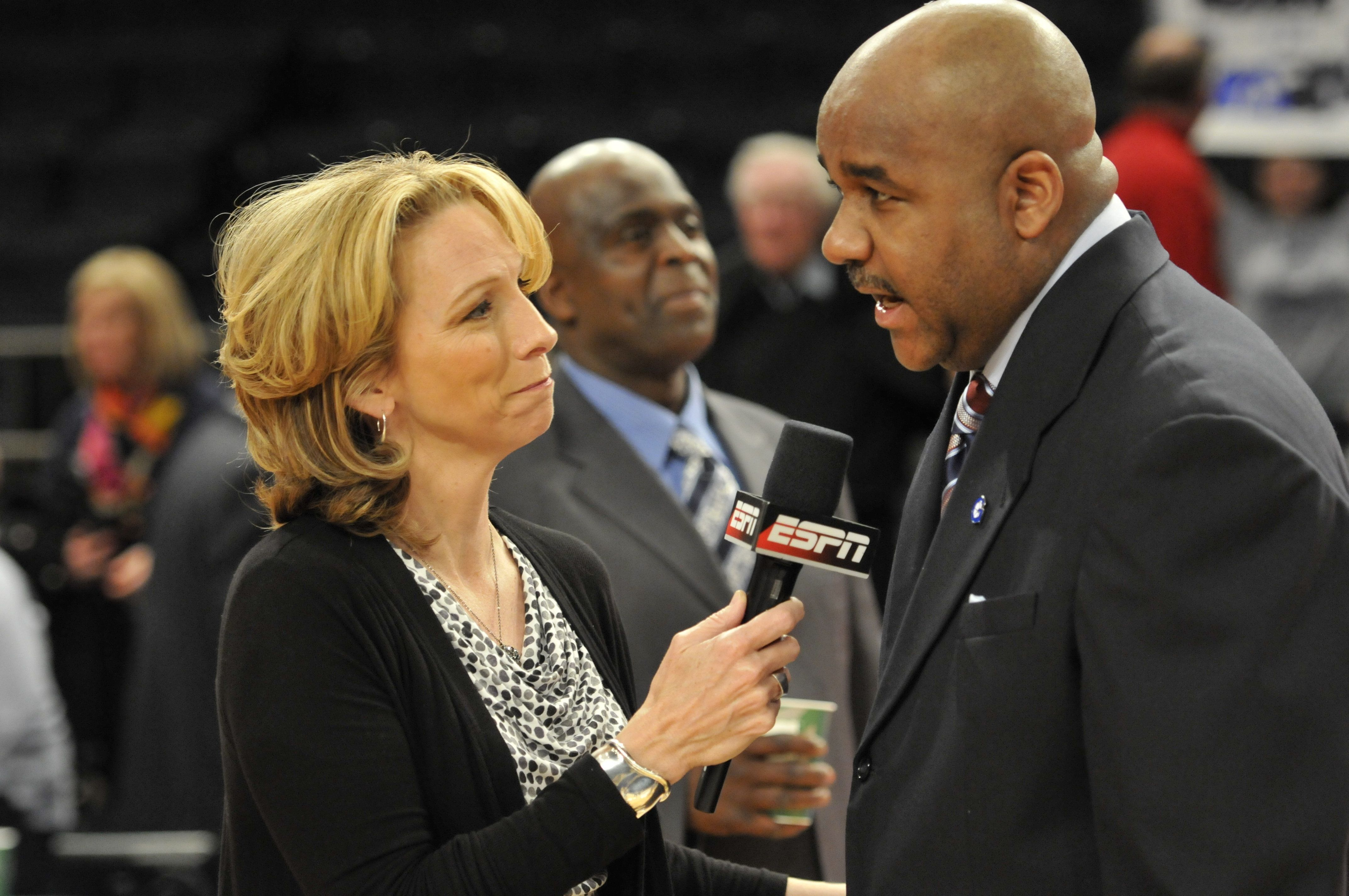 NEW YORK, N.Y.  - MARCH 7, 2012: Head Coach John Thompson III of the Georgetown University Hoyas talks to ESPN reporter Beth Mowins following the Hoyas' win over the University of Pittsburgh Panthers in the second round of the 2012 BIG EAST Conference Men's Basketball Championships at Madison Square Garden in New York, NY on March 7, 2012.  The Hoyas won 64-52. (Photo by Tom Maguire/BIG EAST Conference/Collegiate Images/Getty Images)