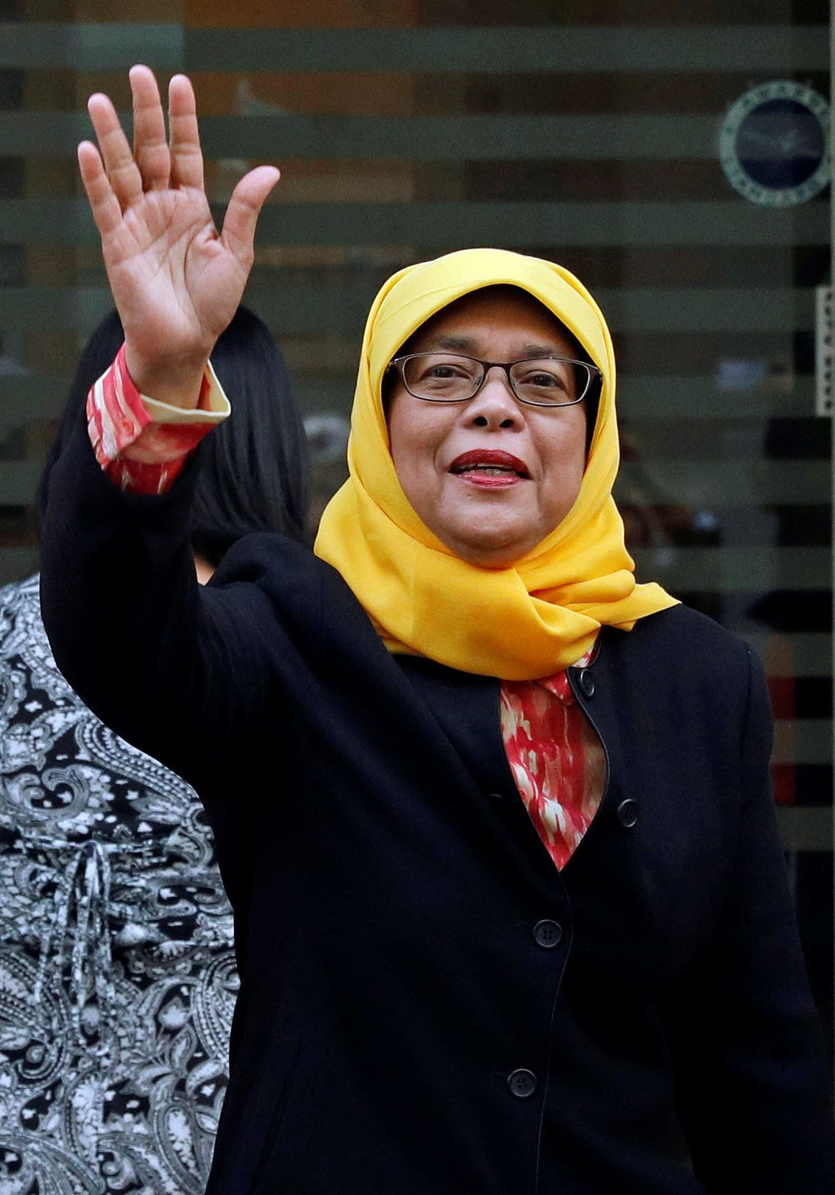 Former speaker of Singapore's parliament, Halimah Yacob, arrives at the Elections Department after she was given the certific
