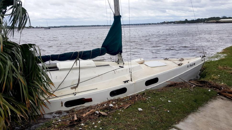 Some sailboats moored in the city's rivers broke loose and crashed against the banks.