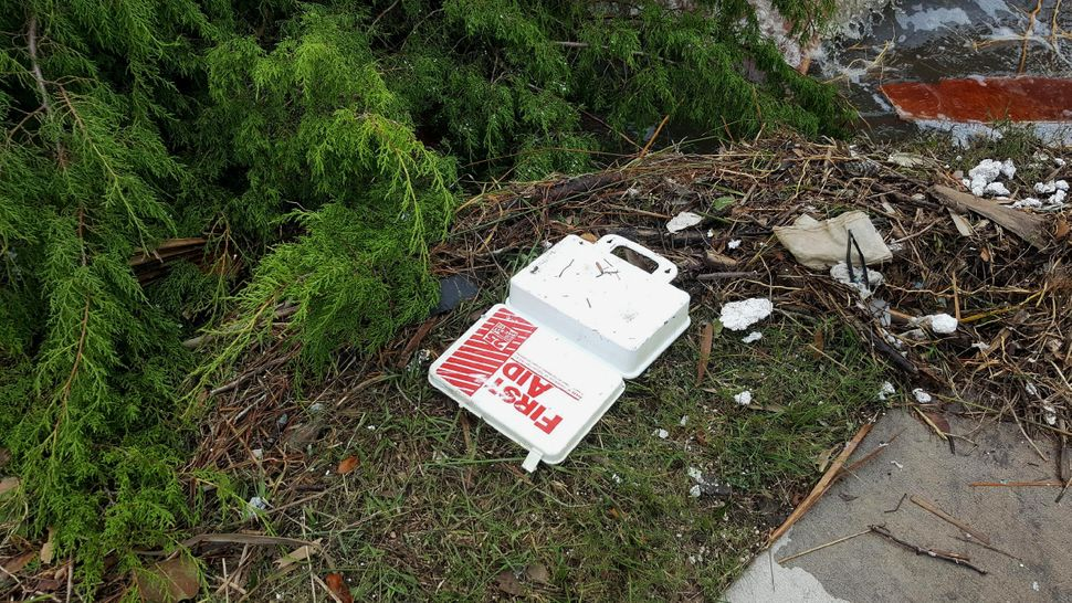 A first aid kit is among the debris strewn about by the storm.
