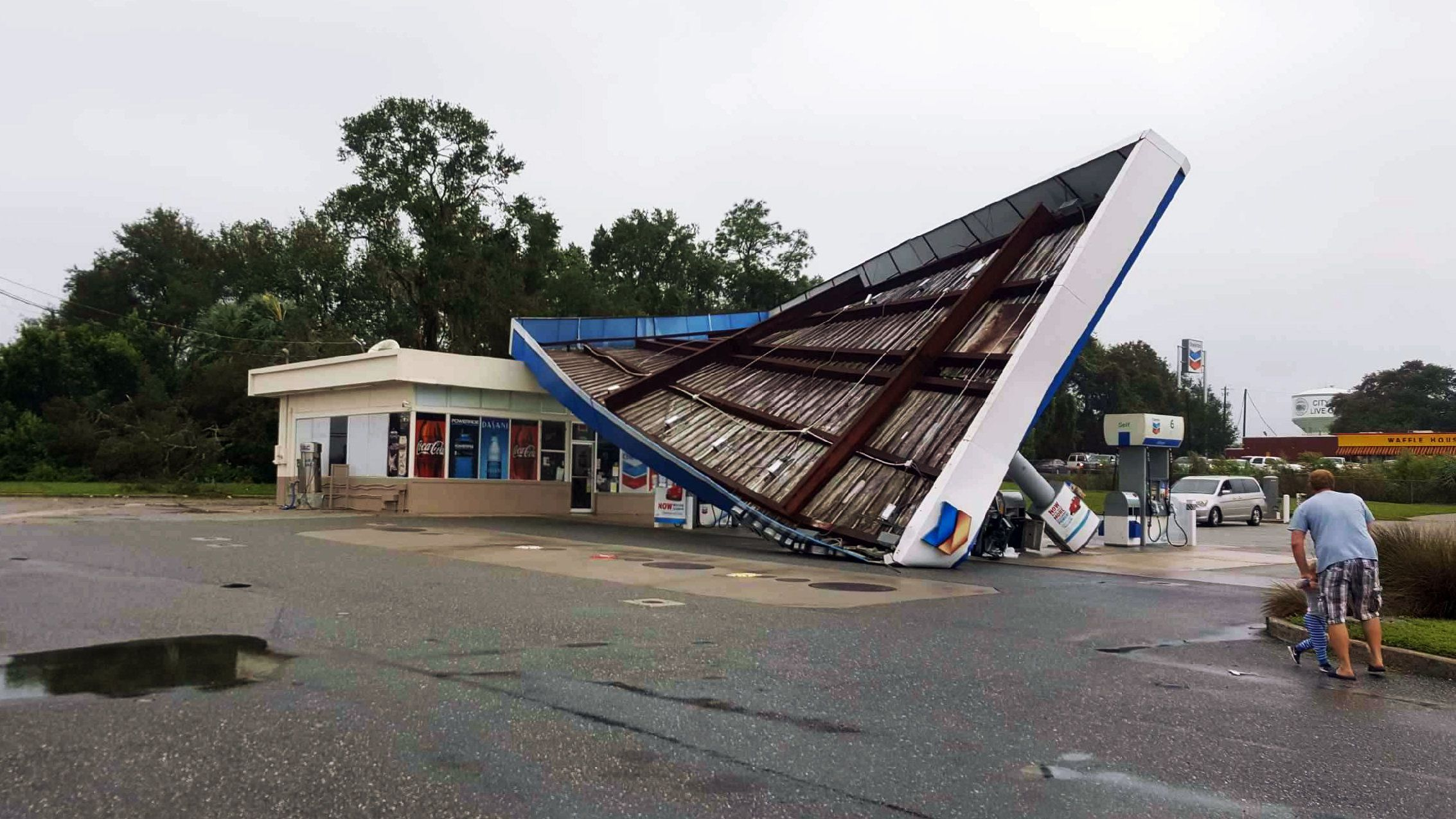 A chevron station blown over in the city of Live Oak Fl