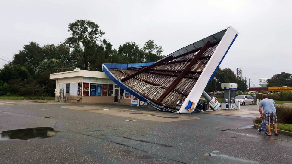 A damaged Chevron station in the city of Live Oak, Florida.
