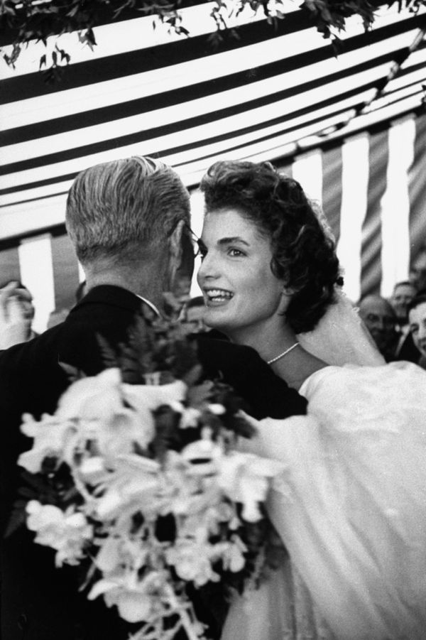 Former US Amb. to Great Britain Joseph Kennedy, dancing with son John F. Kennedy's bride, Jacqueline Bouvier Kennedy, at thei