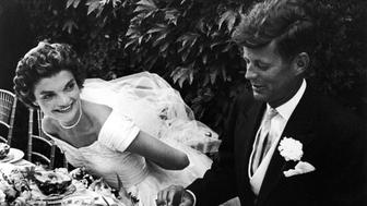 Senator John Kennedy and bride Jacqueline sitting together outdoors at table eating pineapple salad at their wedding reception Photo by Lisa Larsen/Time  Life Pictures/Getty Images