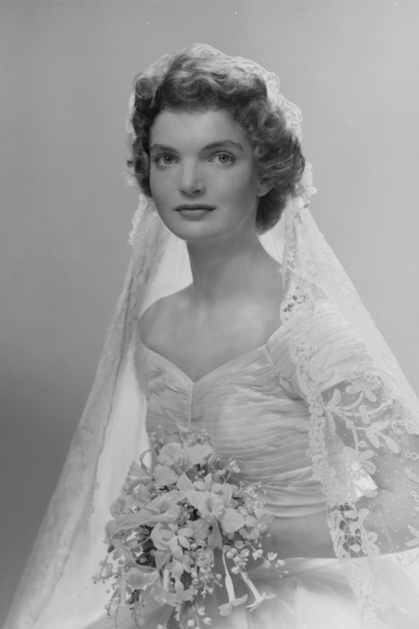Must see photos from john f kennedy and jackie kennedys wedding bridal portrait of jacqueline lee bouvier 1929 1994 shows her in an anne lowe designed wedding dress a bouquet of flowers in her hands new york junglespirit Image collections