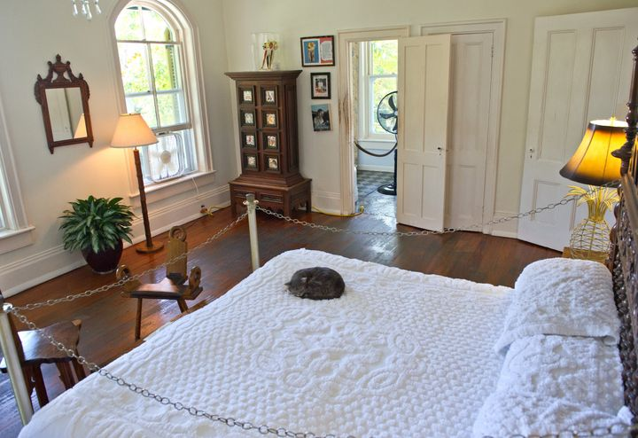 A cat sleeps on a bed on Feb. 18, 2013, at the Key West home where author Ernest Hemingway lived and wrote for a decade.