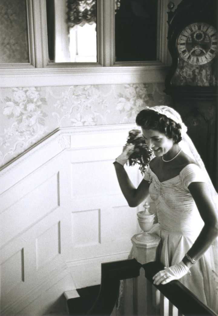 """Kennedy's wedding gown was constructed out of <a href=""""http://www.huffingtonpost.com/2013/02/05/ann-lowe-black-fashion-design"""