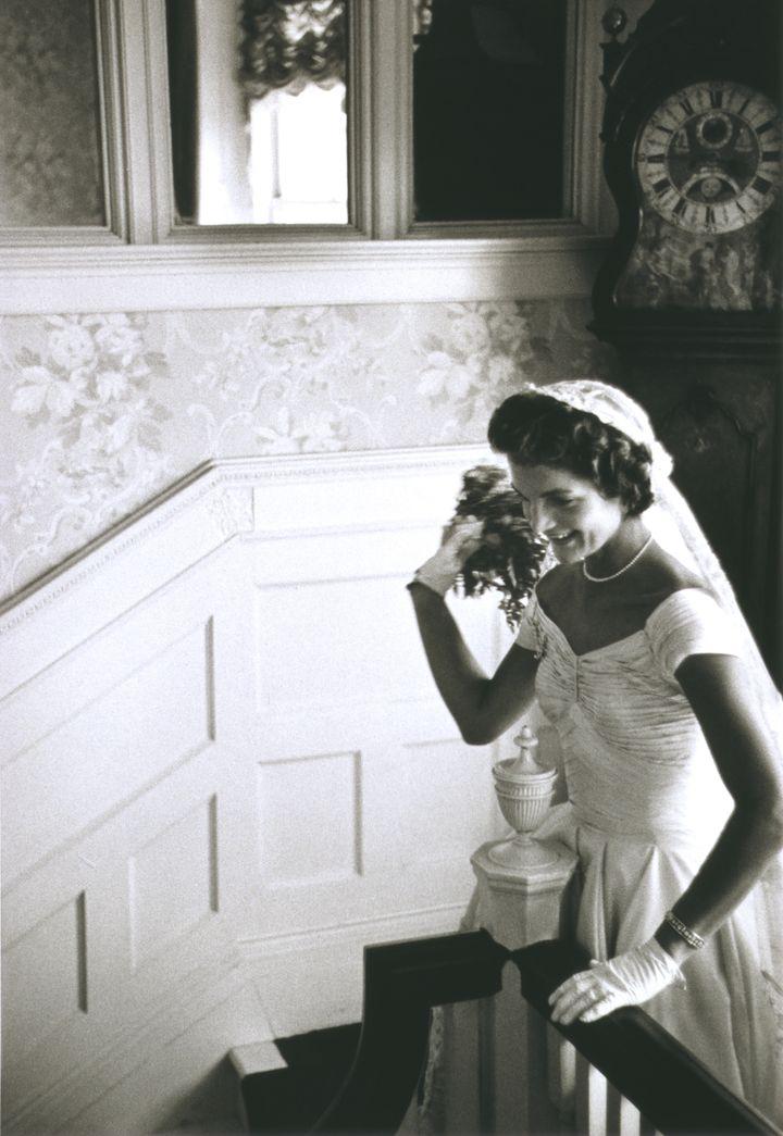 "Kennedy's wedding gown was constructed out of <a href=""http://www.huffingtonpost.com/2013/02/05/ann-lowe-black-fashion-designer-jacqueline-kennedy-wedding-dress_n_2624316.html"">50 yards of ivory silk taffeta.</a>"