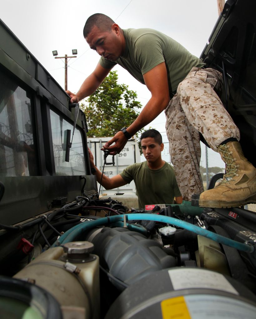Marines with the 15th Marine Expeditionary Unit at Camp Pendleton conduct preventative maintenance weekly on tactical vehicle