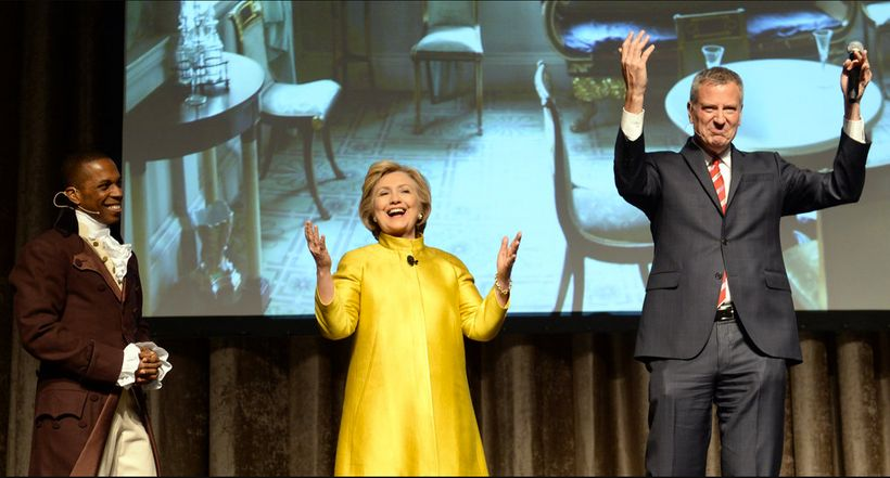 De Blasio and Hillary Clinton with a member of Hamilton the musical