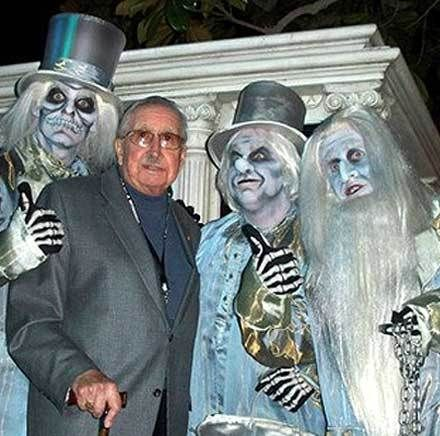 X Atencio and a trio of hitchhiking ghosts posed for a photo at an anniversary event for Disneyland's Haunted Mansion.