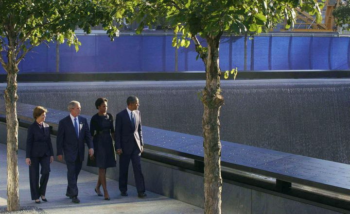 President Barack and First Lady Michelle Obama, accompanied by former President George W. and former First Lady Laura Bush, a