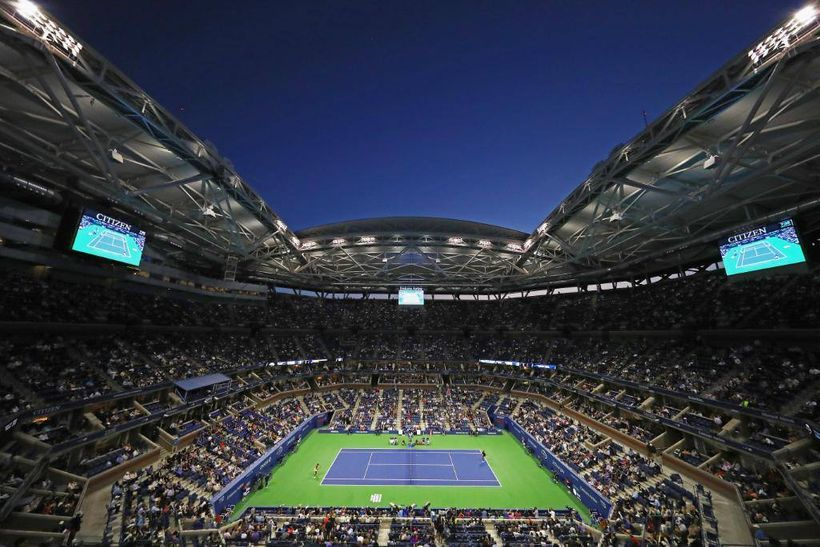"The <a rel=""nofollow"" href=""https://usopen.io-media.com/"" target=""_blank"">Arthur Ashe Stadium</a>, at the <a rel=""nofollow"" h"